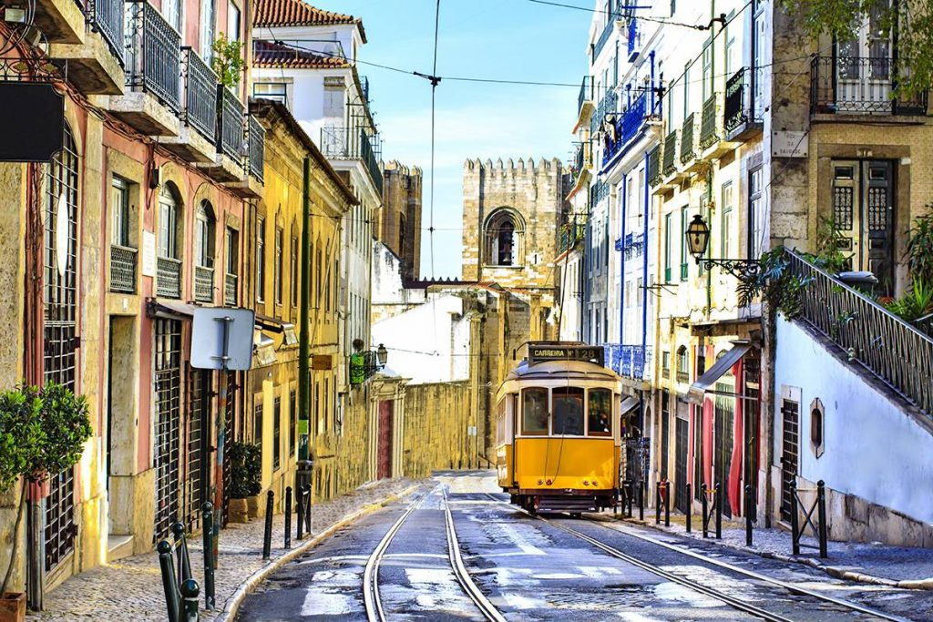 tram going up streets in lisbon