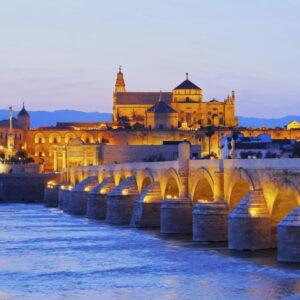 Roman bridge and Córdoba mosque at sunset
