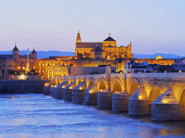 Roman bridge and Córdoba mosque at sunset